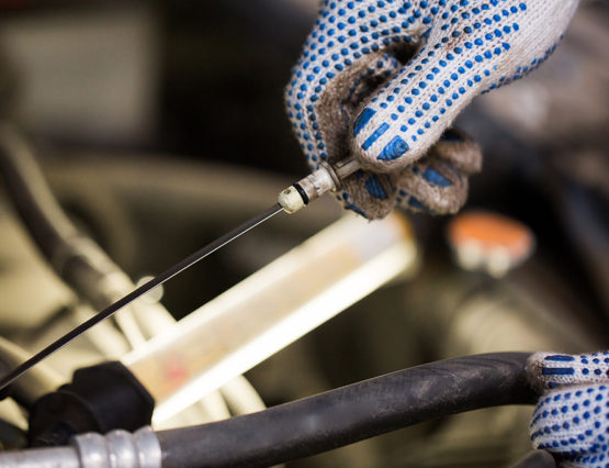 mechanic with dipstick